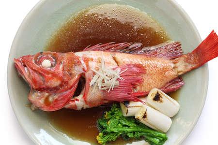 sweetened: simmered kinki rockfish with sweetened soy sauce, japanese cuisine isolated on white background Stock Photo