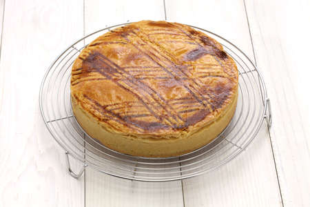 cherry pie: freshly baked, homemade gateau basque on cake cooler