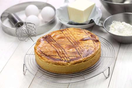 freshly baked, homemade gateau basque on cake cooler