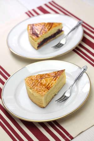 noire: homemade gateau basque, dark cherry jam and custard cream Stock Photo