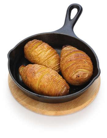 swedish: hasselback potatoes on skillet, swedish food Stock Photo