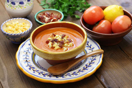 andalusian cuisine: Salmorejo, chilled tomato soup, spanish food isolated on white background