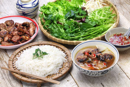 'vietnamese: bun cha, grilled pork rice noodles and herbs and vietnamese cuisine Stock Photo