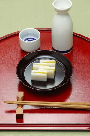japanese cuisine: karasumi daikon, bottarga with radish appetizer for rice wine, japanese cuisine