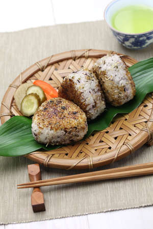 macrobiotic: yaki onigiri, grilled rice balls, japanese food isolated on white background