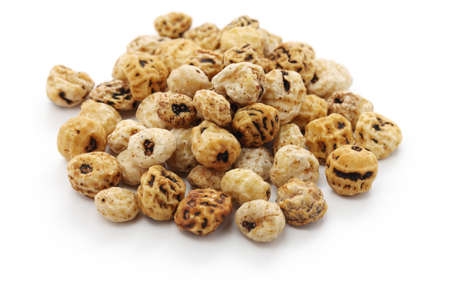 Tiger nuts, spanish chufa, superfoods isolated on white background Stock Photo