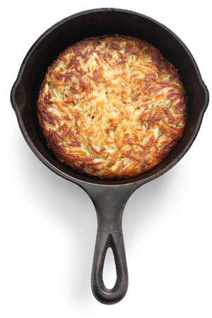 german swiss: Rosti, Swiss potato pancake in frying pan. Shredded potatoes sauteed on both sides until crisp and golden. Stock Photo
