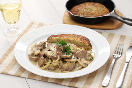 sliced: Zurich-style veal stew and rosti potato, Swiss cuisine Stock Photo
