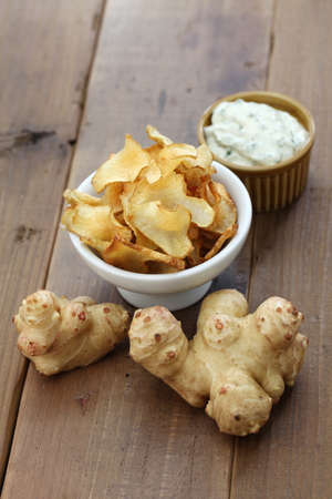 inulin: homemade jerusalem artichoke chips with dipping sauce Stock Photo