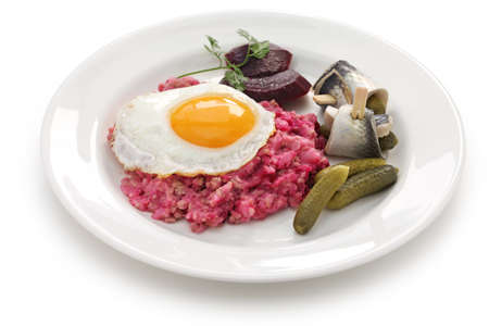 gherkin: labskaus with fried egg, pickled gherkin, beetroot and rollmops