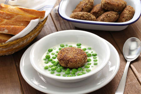 meatloaf: green peas fozelek thich vegetable stew and fasirt fried meatball, hungarian cuisine