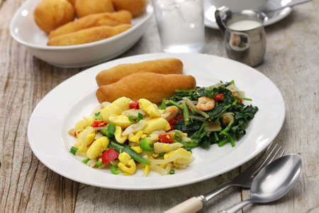 jamaican food: Jamaican breakfast of ackee and saltfish, callaloo, jamaican festivals