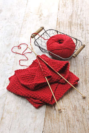 close knit: hand knitted red scarf and heart shaped thread