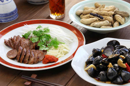 taiwanese: Taiwanese pork sausage, marinated river clam, taiwanese food appetizer