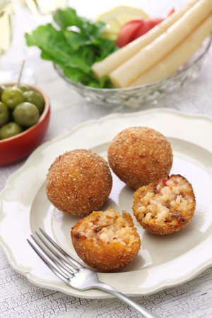 balls deep: arancini di riso, fried risotto rice balls, italian sicilian food