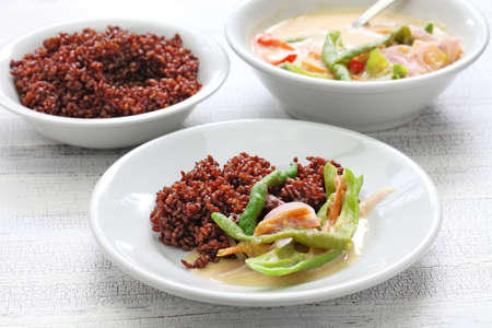 ema: EMA datshi (traditional chili cheese stew) with red rice, bhutanese cuisine