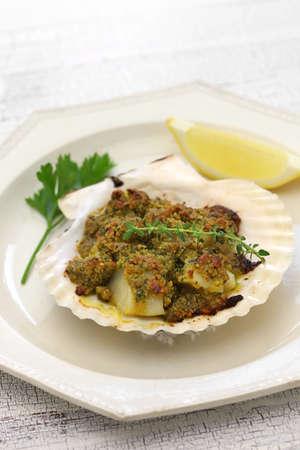 pistachio: capesante gratinate, baked scallop gratin and italian cuisine Stock Photo