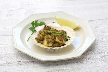 capesante gratinate, baked scallop gratin and italian cuisine Stock Photo