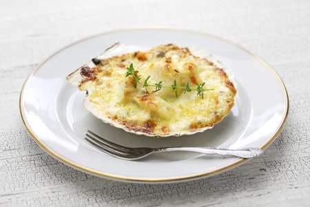 coquilles saint jacques gratin, french scallop cuisine Stock Photo