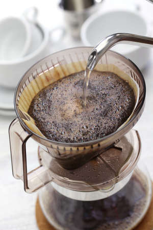 making hand drip coffee by paper filter 스톡 콘텐츠