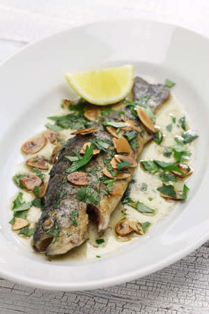 freshwater fish: Trout meuniere amandine, rainbow trout with brown butter and almonds