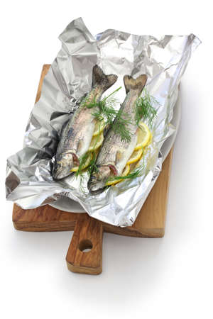 rainbow trout: whole rainbow trout baked in foil (before oven baking).