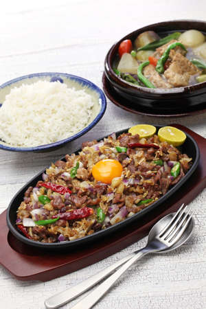 sizzling: sisig and sinigang, filipino cuisine
