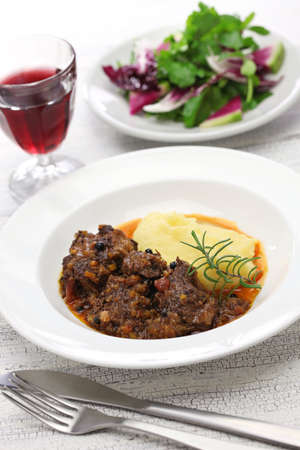 peposo with polenta, tuscan peppered beef stew, traditional italian cuisine