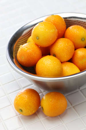 kumquat in the stainless steel bowl Stock Photo