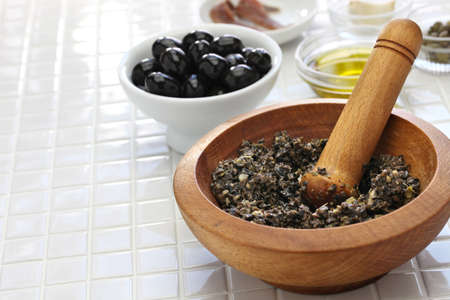 making tapenade, french black olive paste