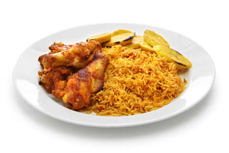 jollof rice with chicken and fried plantain, west african cuisine