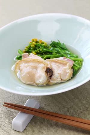 steamed hamaguri clams and field mustard in rice wine, japanese cuisine Stock Photo