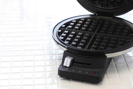 close up food: waffle maker machine Stock Photo