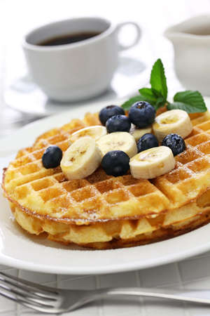 homemade american round waffles with blueberry and banana Stock Photo