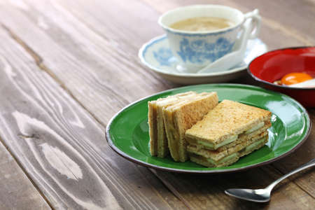 Kaya jam toast sandwich with a cup of white coffee, singaporean malaysian breakfast