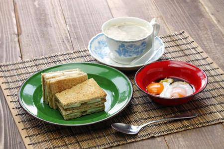 singaporean: Kaya jam toast sandwich with a cup of white coffee, singaporean malaysian breakfast