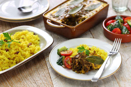 bobotie and yellow rice, south african cuisine. bobotie is a curry flavored meatloaf with baked egg on top. Foto de archivo