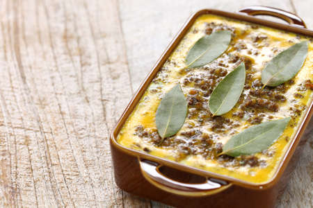 bobotie is a curry flavored meatloaf with baked egg on top. Stok Fotoğraf
