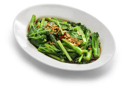 stir fried chinese kale (chinese broccoli) with oyster sauce isolated on white background