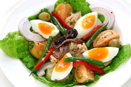 nicoise salad, french cuisine isolated on white background Stock Photo