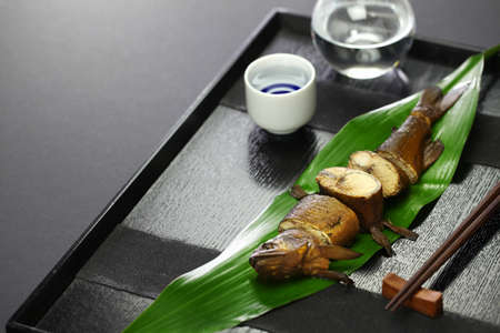komochi ayu no kanroni sweetfish with roe simmered in soy sauce and sugar, japanese appetizer for sake