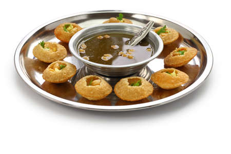 homemade pani puri, golgappa, indian snack isolated on white background