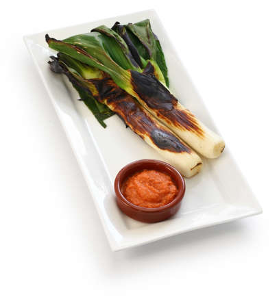 Roasted calcots with romesco sauce for dipping, spanish catalan cuisine Stock fotó