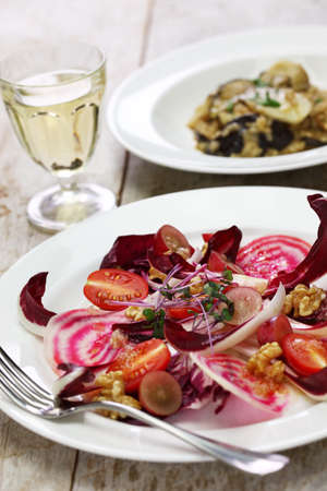 radicchio rosso salad and fresh porcini mushroom risotto Stock Photo