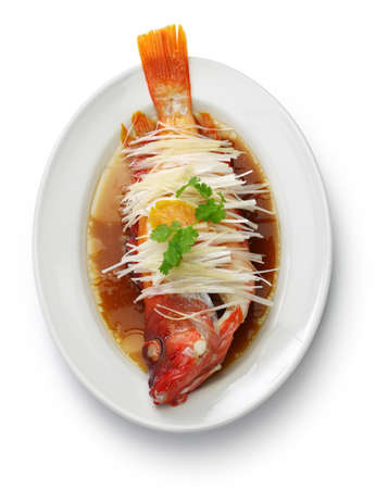 Chinese steamed red grouper with ginger, scallions and soy sauce Stock Photo