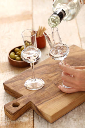 two glasses of Grappa bianca italian digestif, grape-based pomace brandy Foto de archivo
