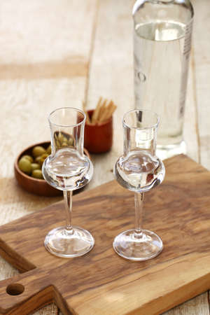 two glasses of Grappa bianca italian digestif, grape-based pomace brandy Stock Photo