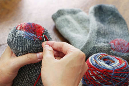 darning socks, repairing holes in socks