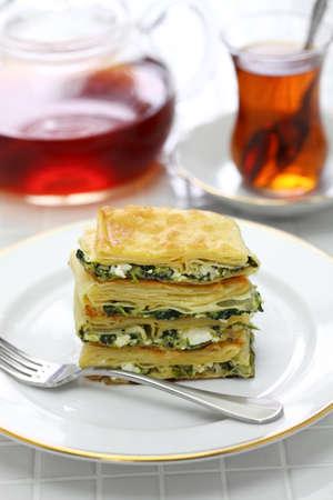 homemade su borek, turkish pie, feta cheese and parsley