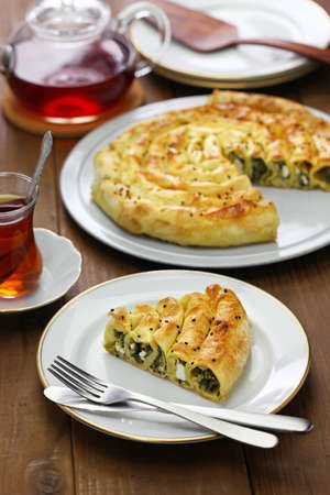 homemade kol borek turkish rounded pie, spinach and feta cheese